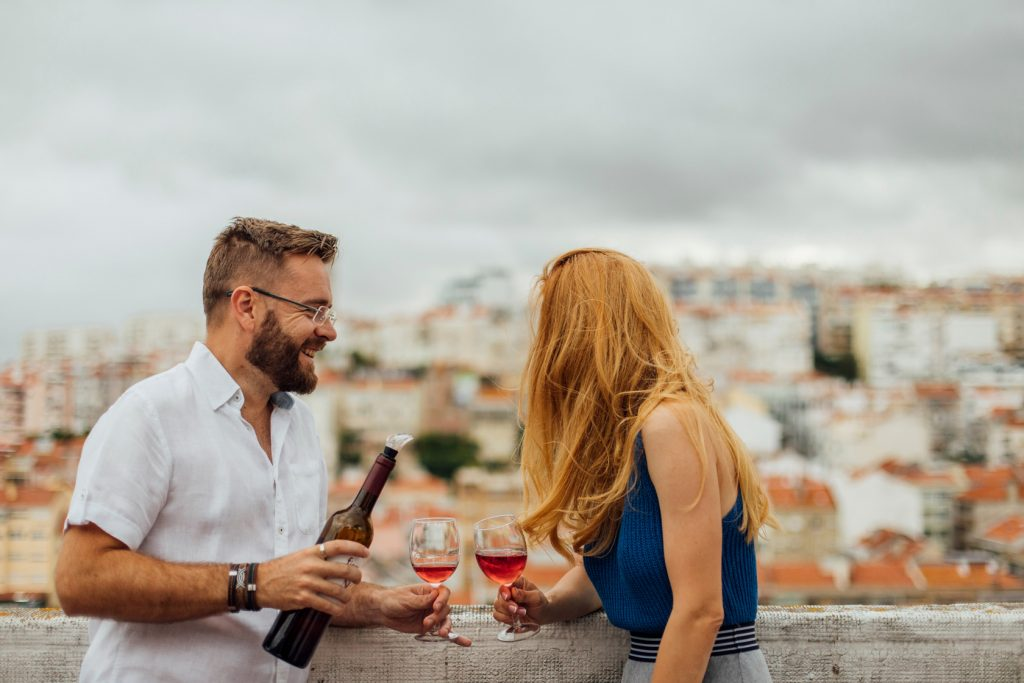 Couple smiling and drinking red wine